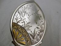 Zilveren dienschep, deels verguld met Japans decor